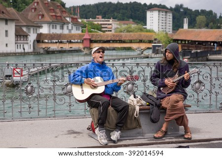 Lucerne, Switzerland June 10 2013 - Two men singing and playing guitars to entertain passersby