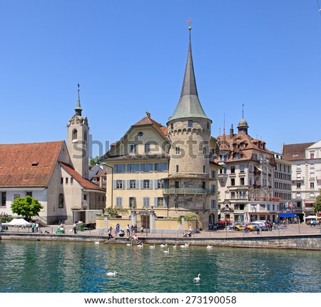 Lucerne, Switzerland - 10 June, 2014: view on the Rathausquai quay across the Reuss river. Lucerne  is a city in central Switzerland and is the capital of the Canton of Lucerne.