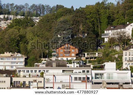 LUCERNE, SWITZERLAND - MAY 05, 2016: Brick buildings and Wooden house among them.