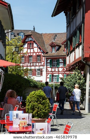 LUCERNE, SWITZERLAND - MAY 06, 2016: Colorful half-timbered houses and unrecognized people enjoying their spare time here it shows the tourist nature of the town