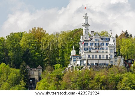 LUCERNE, SWITZERLAND - MAY 04, 2016: Gutsch castle with its hotel and restaurant is located on a hill over the city. Its unique architecture and its location makes it one of the tourist attractions - stock photo