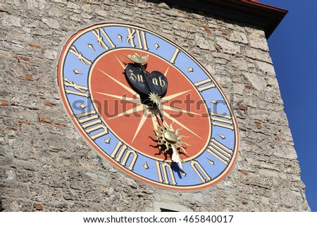 LUCERNE, SWITZERLAND - MAY 08, 2016: The big shield of the clock placed on the tower of Town Hall that was built in the early 1600s. The Clock Tower height it is over 40 meters
