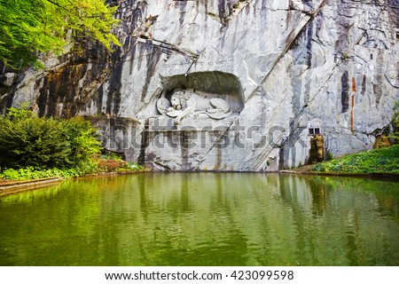LUCERNE, SWITZERLAND - MAY 04, 2016: The monument of Dying Lion was carved in rock wall by the design of Danish artist Thorwaldsen. It is a World famous tourist attractions