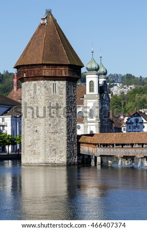 LUCERNE, SWITZERLAND - MAY 05, 2016: The octagonal tall tower was built in the river Reuss and together with roofed Chapel Bridge and the Jesuit Church, there are the most recognizable city landmarks