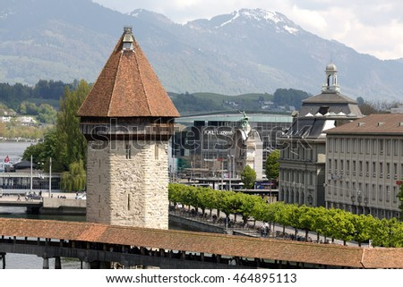 LUCERNE, SWITZERLAND - MAY 04, 2016: The octagonal tall tower was built in the river Reuss and is located next to the roofed Chapel Bridge that are the most recognizable city landmarks