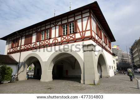 LUCERNE, SWITZERLAND - MAY 02, 2016: The view from outside the building under which the passage leads to the Spreuer Bridge (Spreuerbrucke) that is located on the left bank of the river Reuss.