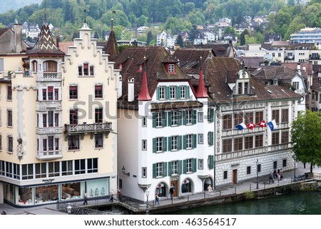 LUCERNE, SWITZERLAND - MAY 02, 2016: Three different facades of historic buildings at the banks of the river Reuss shows the diversity of tourist attractions of the old town