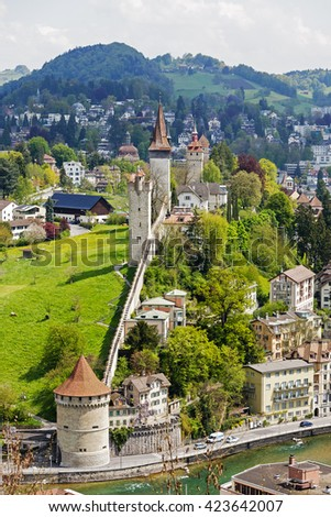 LUCERNE, SWITZERLAND - MAY 04, 2016: Towers of Lucerne's ancient city walls. These historic fortifications are called Musegg and are mostly very well preserved