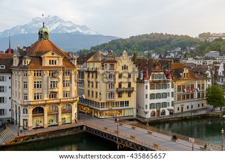 LUCERNE, SWITZERLAND - MAY 02, 2016: Townhouses down by the river Reuss shows the unique character of the city and variety of sightseeing attractions. The town is a destination for many travelers