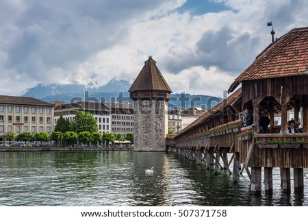 Lucerne, Switzerland - May 24, 2016: View of Lucerne with famous wooden Chapel Bridge in Luzern, Switzerland.
