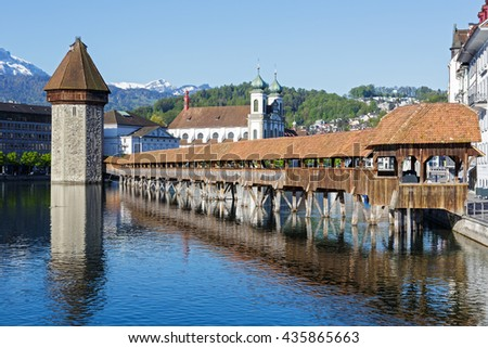 LUCERNE, SWITZERLAND - MAY 05, 2016: View towards Chapel Bridge together with the octagonal tall tower, it is one of the Lucerne's most famous tourists attraction