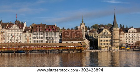 Lucerne, Switzerland - 18 October, 2013: view on the Reuss river and the Chapel Bridge in the morning. Lucerne is a city in central Switzerland, it is the capital of the Canton of Lucerne.