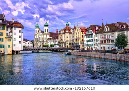 Lucerne, Switzerland, on sunset. View over river Reuss to Jesuit Church - stock photo
