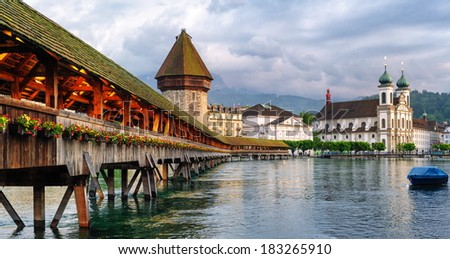 Lucerne, Switzerland, view of Chapel Bridge, Water Tower and Jesuit Church - stock photo