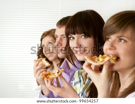 Luck funny Caucasian campaign of four people eating pizza on a light background