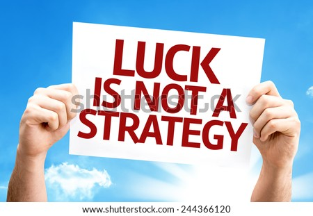 Luck is Not a Strategy card with a beautiful day - stock photo