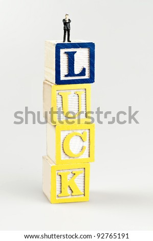 Luck word and toy business man - stock photo