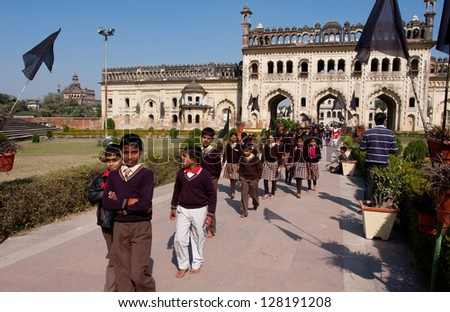 LUCKNOW, INDIA - DEC 19: Unidentified schoolchildren walking from the Gateway of Bara Imambara complex on December 19, 2012 in Lucknow, India. Bara Imambara was built by Nawab of Lucknow in 1784. - stock photo
