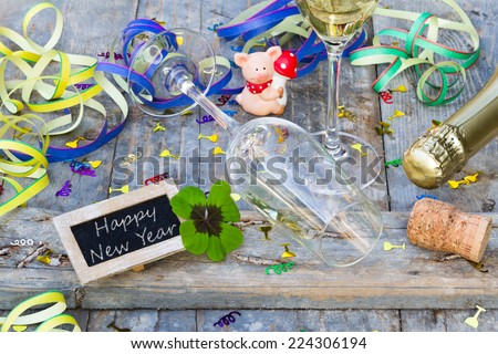 lucky charm and sign with writing, Happy New Year - stock photo