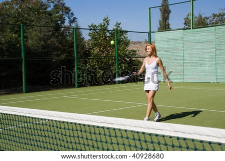 Lucky girl and a friend played tennis on the court - stock photo