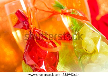 Lucky grapes and champagne to toast the new year - stock photo