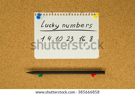 Lucky numbers note message pin on bulletin board - stock photo
