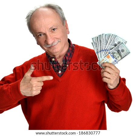 Lucky old man holding dollar bills on a white background