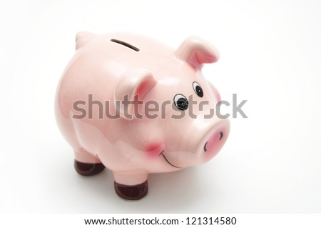 Lucky pink piggy bank over white background