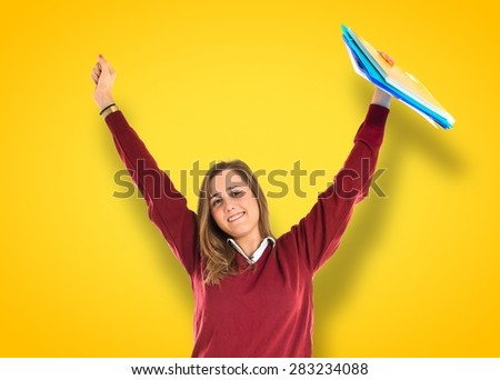 Lucky student over colorful background - stock photo