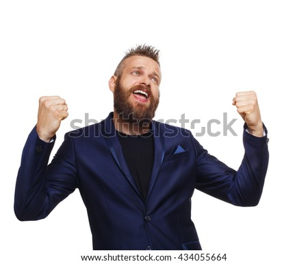 Lucky winner. Emotional man with beard in blue suit happy and joyful of his success. Portrait of bearded businessman. Emotions, yes gesture, facial expressions, feelings, body language, signs. - stock photo