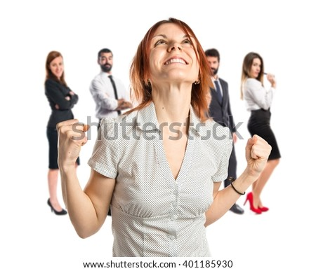Lucky woman over isolated white background - stock photo