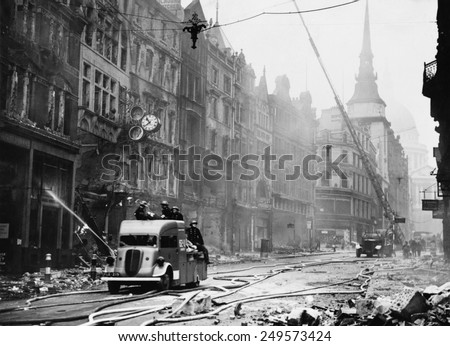 Ludgate Hill area of London with firemen, equipment, and burnt out buildings during the 'Blitz'. Between September 1940 and May 1941, Nazi Germany bombed British cities. - stock photo
