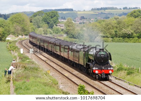 LUDLOW, UK - MAY 19: The Flying Scotsman makes its return journey to Cardiff having left Shrewsbury with a full load of passengers on May 19, 2017 in Ludlow.