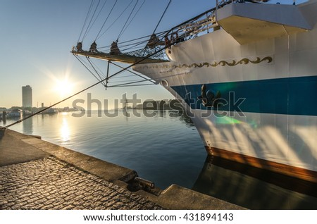 luebeck-.travemuende with historic sail boat, against light