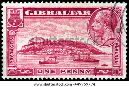 LUGA, RUSSIA - JUNE 25, 2016: A stamp printed by GIBRALTAR shows image portrait King George V against view of Gibraltar Rock, circa 1931