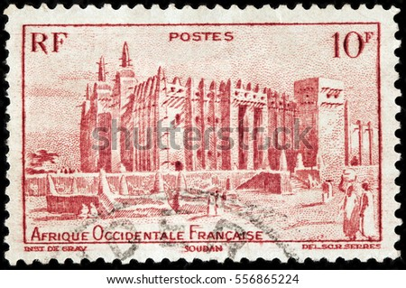 LUGA, RUSSIA - NOVEMBER 29, 2016: A stamp printed by FRENCH WEST AFRICA shows view of Great Mosque of Djenne. Mosque is located in the city of Djenne, on flood plain of Bani River, circa 1947