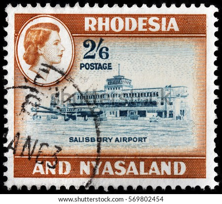 LUGA, RUSSIA - SEPTEMBER 18, 2015: A stamp printed by RHODESIA AND NYASALAND shows image portrait of Queen Elizabeth II against view of Salisbury Airport, circa 1959