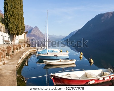 Lugano Gandria, Switzerland: Small boats moored along the shore of the small village on the lake of Lugano