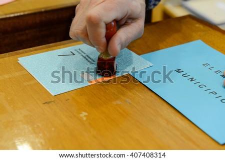 Lugano, Switzerland - 11 april 2016: Hand  validating a voting ballot at the municipal election of Lugano on Switzerland - stock photo
