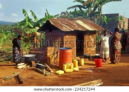 LUGASA, UGANDA - JULY 30: School kitchen of village school on July 30, 2004 in Lugasa village, Buikwe region, Uganda. Most children can walk to school thanks to foreign charity - stock photo