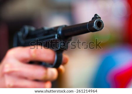 Luger Parabellum automatic pistol in a human hand, shallow depth of field. close-up - stock photo