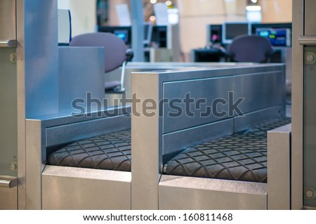Luggage accept terminal with baggage handling belt conveyor system at check in desk in airport