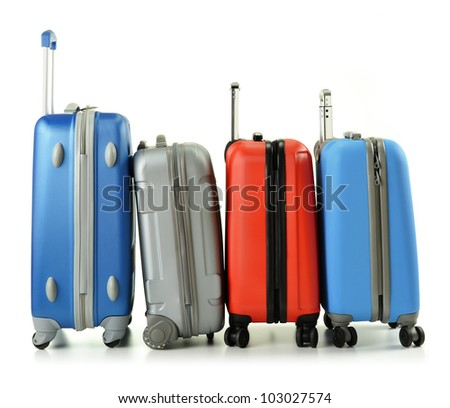 Luggage consisting of four polycarbonate suitcases standing in the row isolated on white - stock photo
