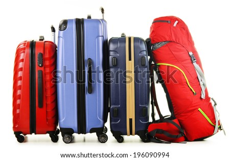 Luggage consisting of large suitcases and rucksack isolated on white. - stock photo