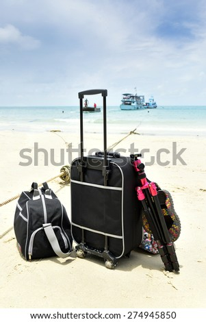 Luggage handling and tripods luxury vacation for travel luggage with the luggage on a background of blue sea. And vessels  - stock photo