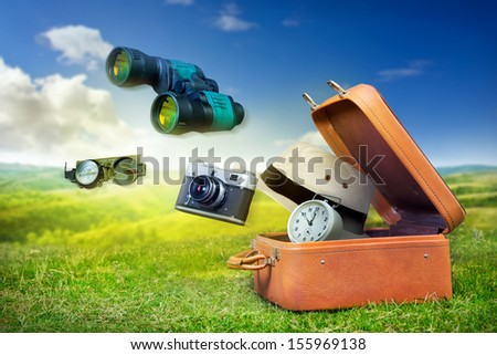 Luggage of an adventurer, travel concept background  - stock photo