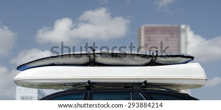 Luggage on car roof rack for vacations