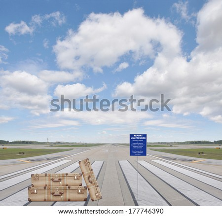 Luggage Report Unattended Baggage / Packages or suspicious behavior anywhere in the airport or plane to police or airline personnel. It's a federal offense to joke or give false information. Runway - stock photo