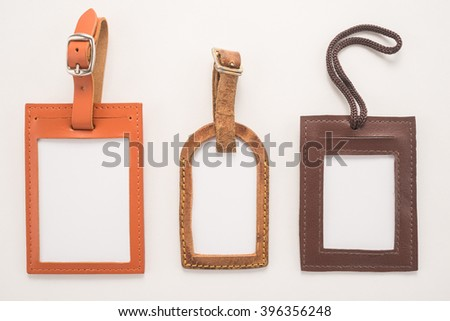 Luggage tags on white background