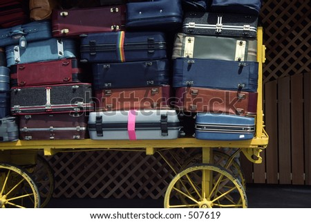 Luggage waiting to be loaded - stock photo
